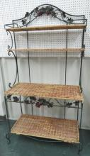 WROUGHT IRON BAKERS RACK WITH GRAPE MOTIF & WICKER SHELVES. HEIGHT 6'; WIDTH 38