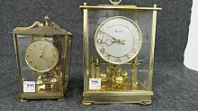 LOT (2) MASTER & SCHATZ BRASS ANNIVERSARY CLOCKS, C.1960. HEIGHT 8 1/2-11