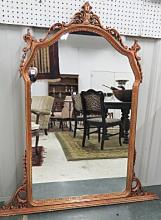 CARVED AND COPPER GILT FRAMED MIRROR. HEIGHT 53