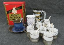 LOT INCLUDING (2) GOLD WASH ON STERLING (VERMEIL) AND ENAMEL NORNE DEMI-TASSE SPOONS, SOPPIL ESPRESSO CUPS, SILVER PLATE HOLDERS, SAUCERS, (8) SPOONS, CHIRATORN CHIRAPRAVATI CUP, UPSALAEKEBY CUP AND SAUCER AND VINTAGE 8'OCLOCK COFFEE TIN