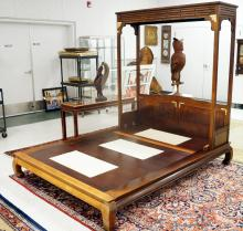 BERNHARDT CHINESE STYLE CARVED AND BRASS MOUNTED HARDWOOD BED. HEIGHT 81