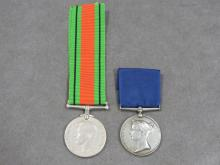 LOT (2) INCLUDING BRITISH NAVAL LONG SERVICE AND GOOD CONDUCT MEDAL, 19TH CENTURY; BRITISH WWII DEFENSE MEDAL, 1945