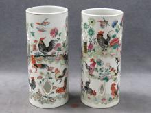 PAIR CHINESE FAMILLE ROSE DECORATED PORCELAIN WIG STANDS. HEIGHT 11