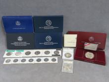 LOT (21) INCLUDING US COMMEMORATIVE SILVER COINS; 1984, 1988 AND 1992 OLYMPICS; 2002 WEST POINT; 2000 LIBRARY OF CONGRESS; 1986 LIBERTY SET; (5) KENNEDY HALVES (B/U); (7) STATE QUARTERS (PROOF); 1981-S SBA DOLLAR (PROOF)