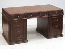 GERMAN CARVED WALNUT DOUBLE PEDESTAL DESK