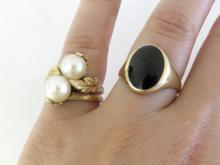 LOT (2) 14K YELLOW GOLD RINGS INCLUDING ONYX, RING SIZE 8 1/2 AND DOUBLE PEARL LEAF DESIGN. RING SIZE 7; GROSS WEIGHT 12.78 GRAMS