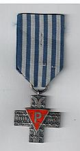 Auschwitz Cross - a Medal of Honor of the Polish government which was given to the prisoners of the camps