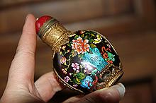 An Important Qing Gold Gilt Peking Class Flowers Snuff Bottle