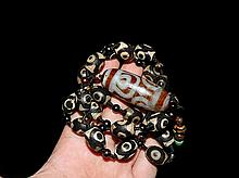 An Important Qing Dzi Beads Necklace
