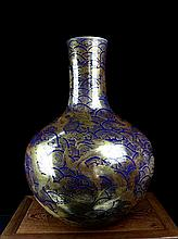 A Large Gilt Mirror Blue Nine Dragons Porcelain Bottle Vase