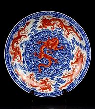 A Large B/W and Alum Red Nine Dragons Porcelain Plate