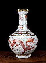 A Gilt Famille Rose Dragon and Phoenix Porcelain Vase