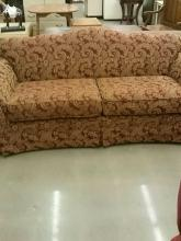 Red sofa with gold designs