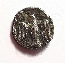 A silver quarter obol of Yehud Medinata during the Persian period