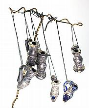 seven Glass juglet pendants, 4th-5th cent CE