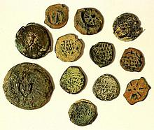 A representative lot of Hasmonaean coins of different types