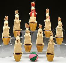 NINE-PIECE STEIFF FELT RABBIT SKITTLE SET ON WOODEN PLINTHS.