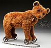 EARLY CINNAMON BROWN CENTER SEAMED STEIFF BEAR ON WHEELS.