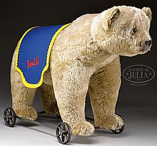 CIRCA 1912 BLOND STEIFF BEAR ON WHEELS WITH BUTTON.