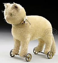 EARLY WHITE STEIFF MOHAIR CAT WITH BUTTON ON WHEELS.