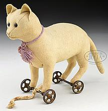 LOVELY AND EARLY STEIFF FELT CAT ON WHEELS WITH BLANK BUTTON.