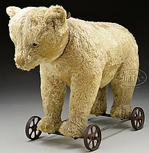 EARLY WHITE CENTER SEAMED STEIFF BEAR WITH BUTTON ON METAL WHEELS.