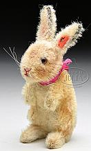 1930s ERA STEIFF MOHAIR BEGGING RABBIT WITH BUTTON AND HEAD TURNS TAIL MECHANISM.