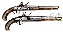 PAIR OF REVOLUTIONARY WAR PERIOD RELIEF CARVED FLINTLOCK PISTOLS ATTRIBUTED TO WILLIAM SHENNER OF READING, PA, POSSIBLY OWNED BY REVOLUTIONARY WAR ERA CAPTAIN REYNOLDS.