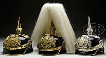 LOT OF THREE BAVARIAN LIGHT CAVALRY OFFICER'S HELMETS.