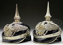 TWO PRUSSIAN FIRST GUARD OF FOOT OFFICER'S HELMETS.