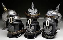 LOT OF SIX WWI ERA LOBSTERTAIL HELMETS AND JAEGER SHAKOS.