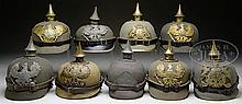 LOT OF NINE IMPERIAL GERMAN WARTIME FELT ERSATZ HELMETS CIRCA 1914.