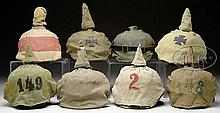 SELECTION OF IMPERIAL GERMAN SPIKED HELMETS WITH FIELD COVERS.