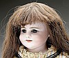 GERMAN BISQUE SHOULDER HEAD DOLL.