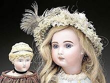 LOT OF TWO BISQUE DOLLS.