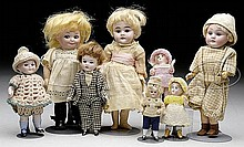 LOT OF EIGHT GERMAN SMALL BISQUE DOLLS.