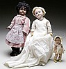 LOT OF TWO GERMAN BISQUE DOLLS AND ONE AMERICAN COMPOSITION DOLL.