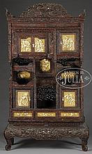 OUTSTANDING ORIENTAL CARVED HARDWOOD DISPLAY CABINET WITH ELABORATE CARVED IVORY MOUNTS.