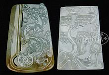 TWO CARVED JADEITE PENDANTS.