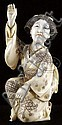 CARVED IVORY FIGURE OF A GEISHA.