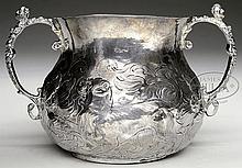 EXCEPTIONAL STERLING 1684 BULBOUS FORM, REPOUSSE DECORATED, CAUDEL CUP.