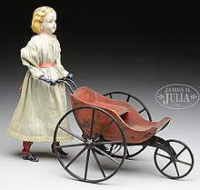 EARLY CLOCKWORK PRAM WITH DOLL.