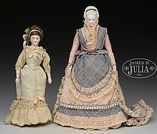 LOT OF 2 SMALL LADY DOLLS.