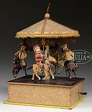 GERMAN 4-HORSE CAROUSEL TOY WITH MUSIC BOX.