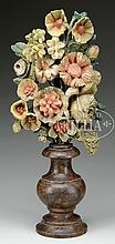 FINE AND UNUSUAL FLORAL CARVING ON PEDESTAL.