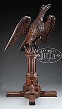 EXCEPTIONAL CARVED WALNUT ARCHITECTURAL EAGLE ON PEDESTAL.