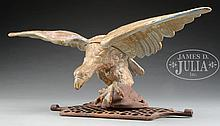 CAST-IRON DISPLAYED EAGLE MOUNTED ON A GRATE.