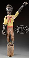 FOLK ART CARVED LIFE SIZE FIGURE OF AN AFRICAN AMERICAN.