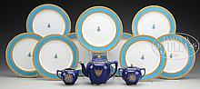 NINE DECORATED SERVICE PLACES AND THREE-PIECE SILVER OVERLAY PORCELAIN TEA SET.
