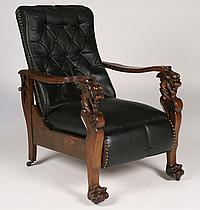 CARVED OAK GRIFFIN DECORATED MORRIS CHAIR